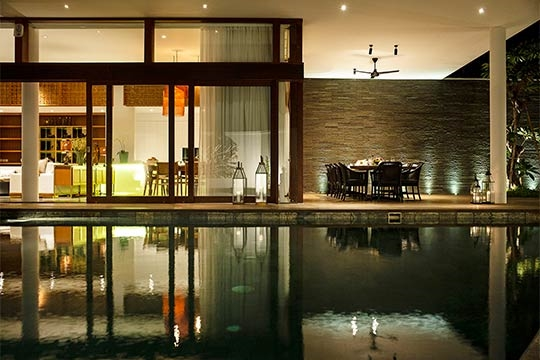 Pool and dining area at night